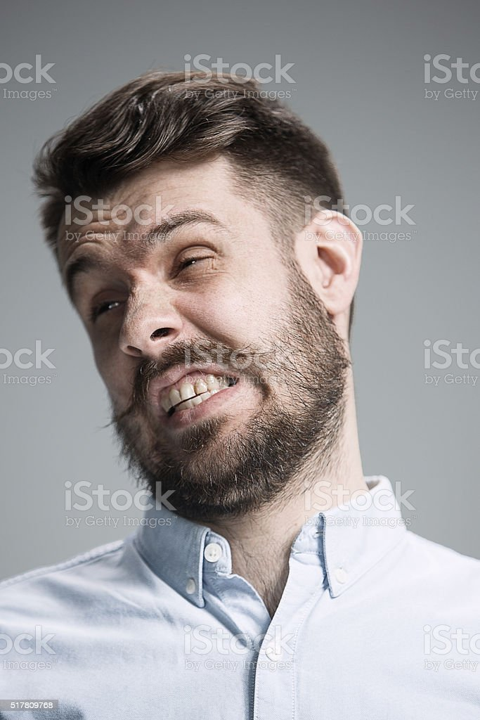 portrait of disgusted man stock photo