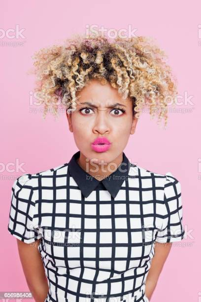 Portrait Of Displeased Afro American Young Woman Stock Photo - Download Image Now