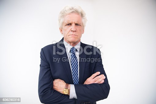 istock Portrait of displeased senior businessman in suit 636290316