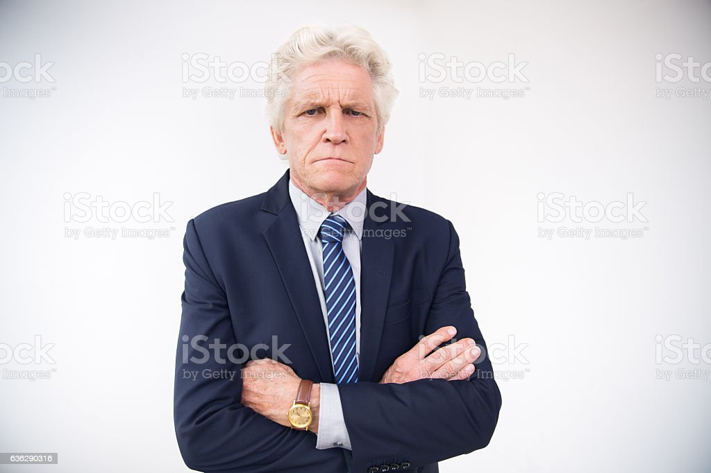 Portrait of displeased senior businessman in suit stock photo