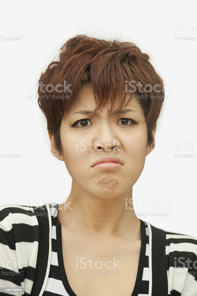 Portrait of displeased young woman, studio shot royalty-free stock photo