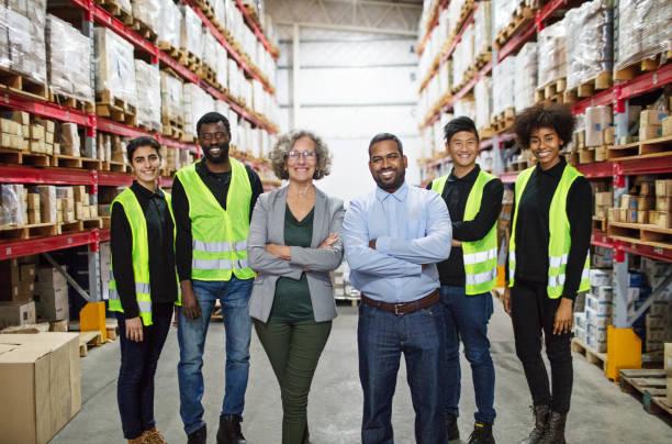 Portrait of distribution warehouse working team stock photo