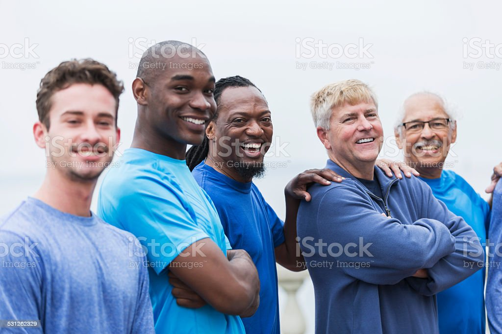 Portrait of diverse group of men standing outdoors stock photo