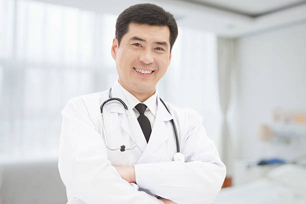 Portrait of Doctor Standing With Arms Crossed stock photo
