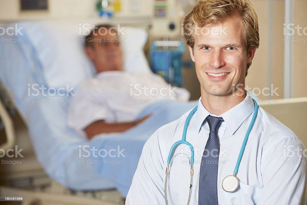 Portrait Of Doctor With Patient In Background royalty-free stock photo