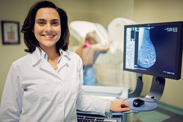 Portrait of doctor working with mammography X-ray scanner in hospital Portrait of doctor working with mammography X-ray scanner in hospital publicity event stock pictures, royalty-free photos & images