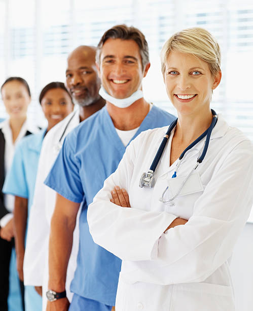 Portrait of doctors standing in a row stock photo