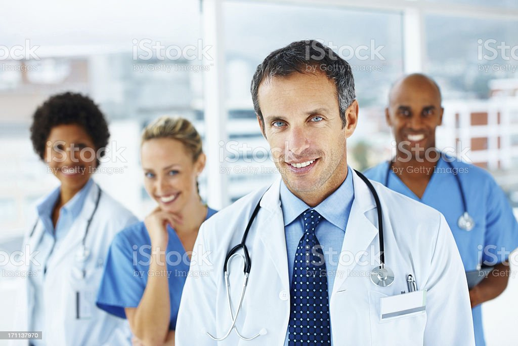 Portrait of doctors standing together and smiling royalty-free stock photo