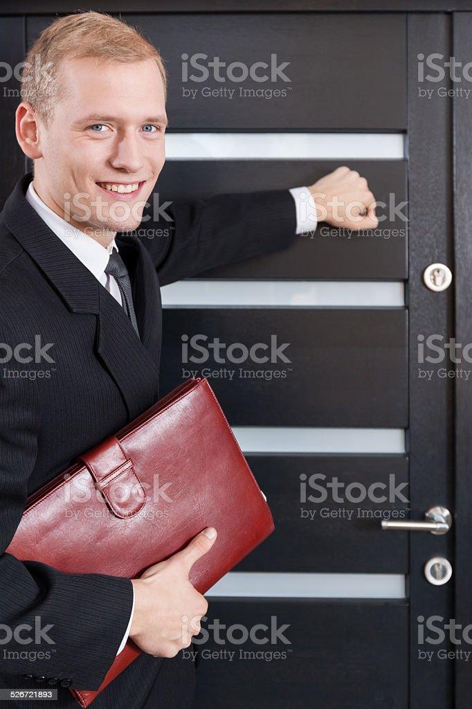 Portrait of door-to-door salesman stock photo