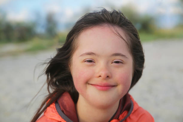Portrait of down syndrome girl smiling Portrait of down syndrome girl smiling persons with disabilities stock pictures, royalty-free photos & images