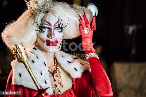 istock Portrait of drag queen in red dress 1160103157