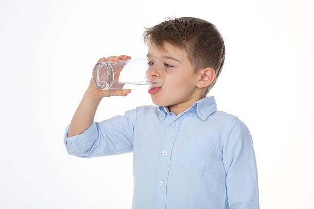portrait of drinking child stock photo