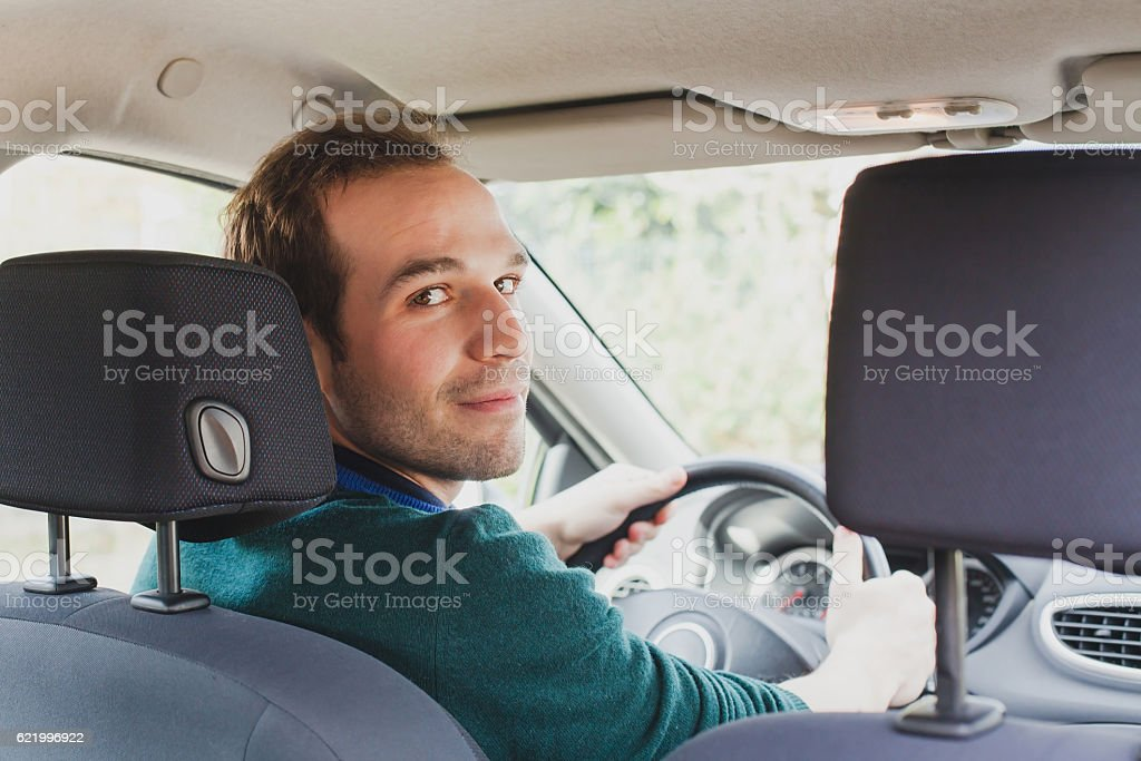 portrait of driver in the car or taxi stock photo