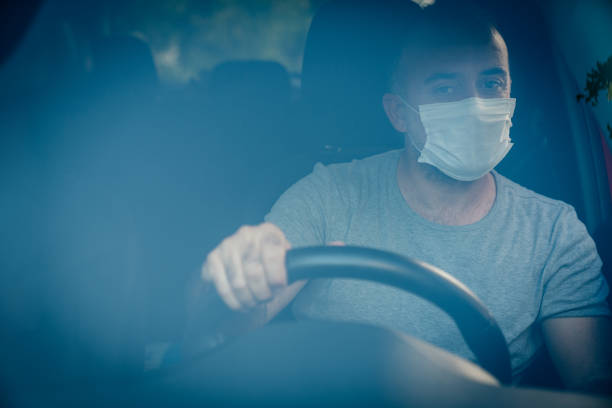 Portrait of driver wearing protective medical mask stock photo