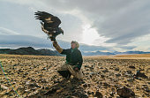 Portrait of eagle hunter  in steppe in Mongolia
