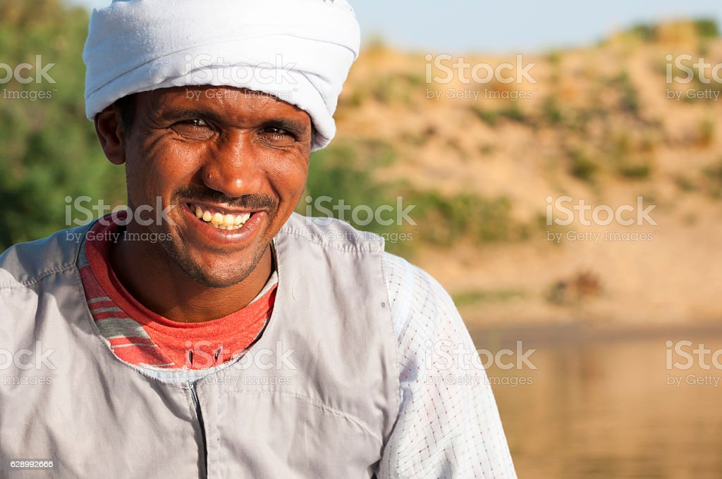 Portrait of Egyptian man on Nile River stock photo