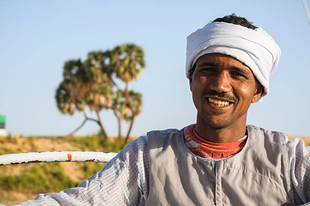portrait of egyptian man on nile river - north africa stock photos and pictures