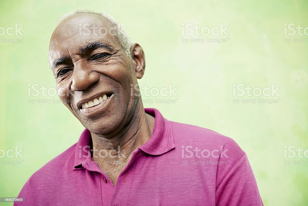 Portrait of elderly black man looking and smiling at camera stock photo