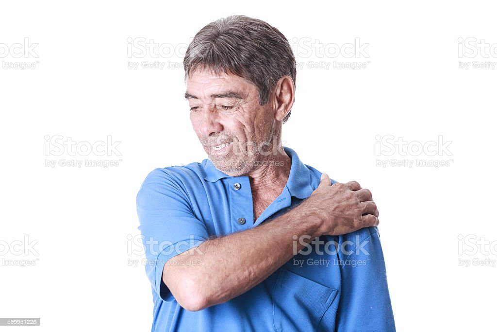 Portrait of elderly man suffering from shoulder pain stock photo