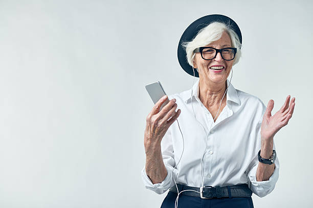 portrait of elderly woman in hipster clothes - hipster persona foto e immagini stock