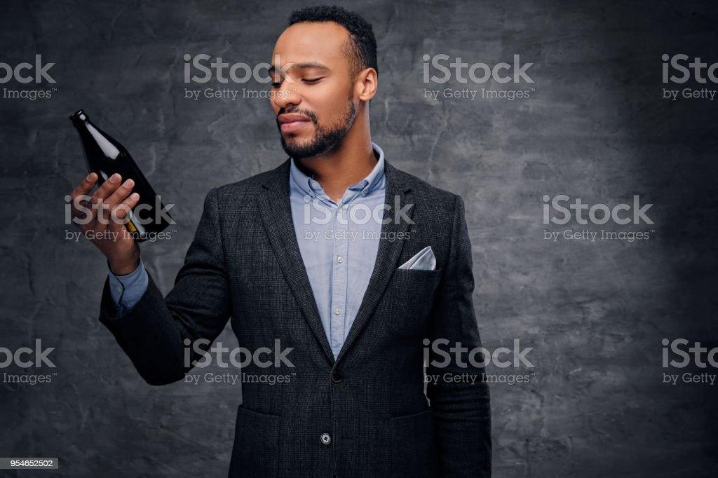 Studio portrait of elegant black American male dressed in a suit...
