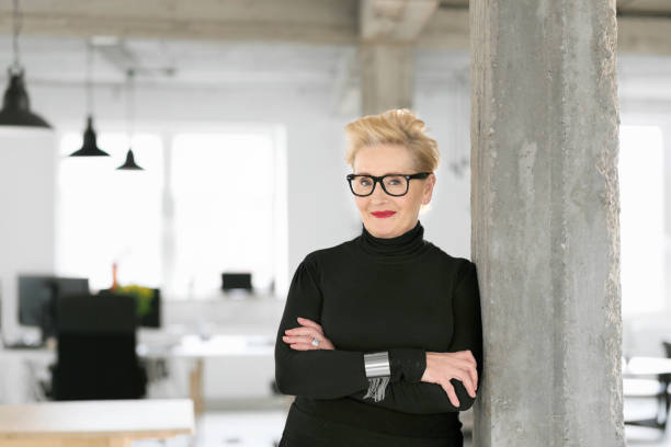 Portrait of elegant senior businesswoman in the modern studio stock photo