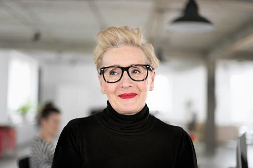 Portrait Of Elegant Senior Businesswoman In The Studio Stock Photo - Download Image Now