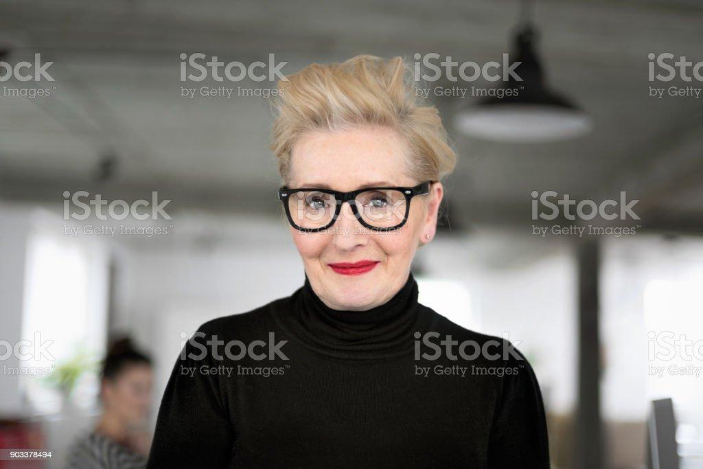Portrait of elegant senior businesswoman in the studio stock photo