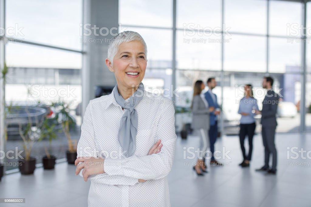 Portrait of elegant senior businesswoman stock photo