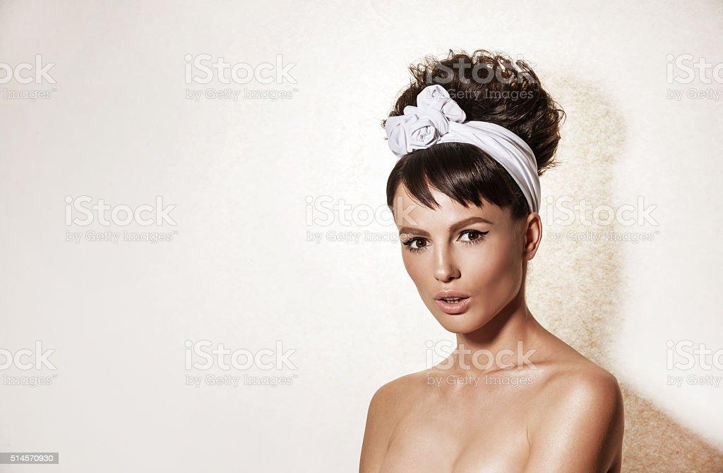 Portrait Of Elegant Woman With Retro Hairdo And Makeup Stock Photo