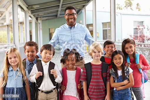 istock Portrait of elementary school kids and teacher in corridor 515273634