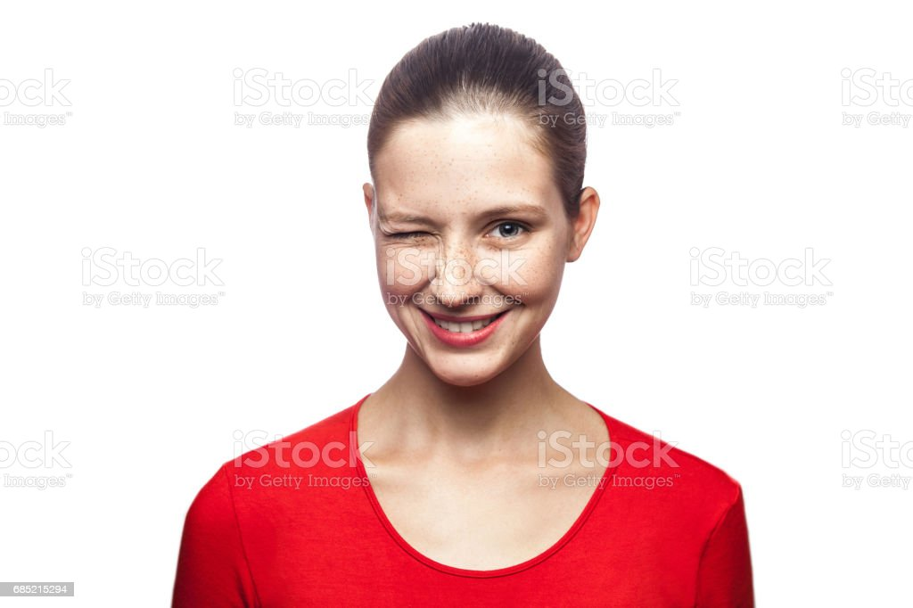 Portrait of emotional woman with freckles and red t-shirt stock photo