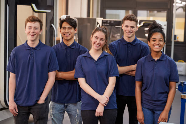 Portrait Of Engineering Apprentices In Factory Portrait Of Engineering Apprentices In Factory apprentice stock pictures, royalty-free photos & images