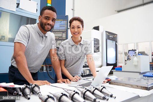 Portrait Of Engineers Using CAD Programming Software On Laptop