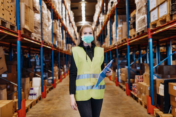 Portrait of essential workers with face masks during coronavirus epidemic