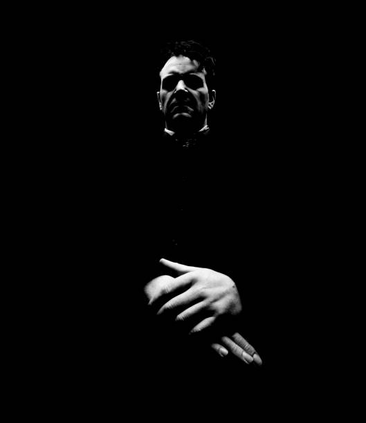 Portrait of Evil Looking Priest, Low Key Toned stock photo