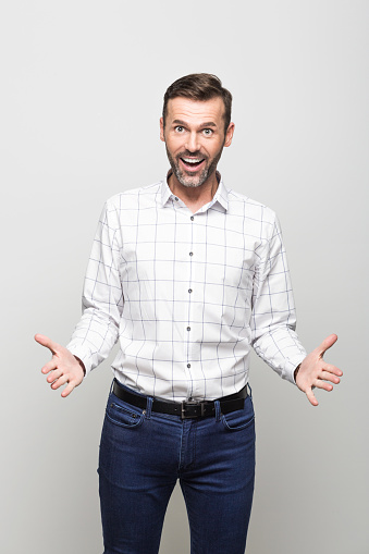 Portrait Of Excited Businessman Laughing At Camera Grey Background Stock Photo - Download Image Now