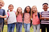 istock Portrait Of Excited Elementary School Pupils On Playing Field At Break Time 1160929152