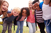 istock Portrait Of Excited Elementary School Pupils On Playing Field At Break Time 1160930701