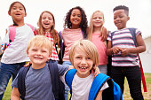 istock Portrait Of Excited Elementary School Pupils On Playing Field At Break Time 1160932268