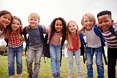 istock Portrait Of Excited Elementary School Pupils On Playing Field At Break Time 1160932512