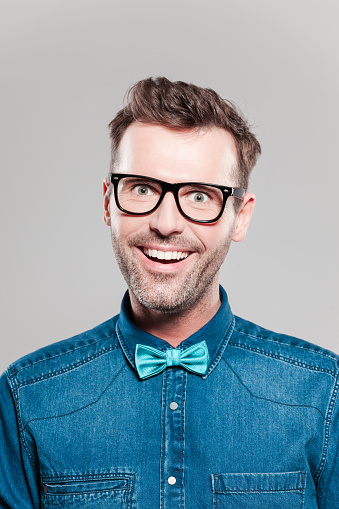 Portrait Of Excited Man Wearing Jeans Shirt Bow Tie Glasses Stock Photo - Download Image Now