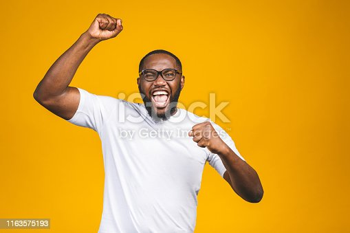 Portrait of excited young African American male screaming in shock and amazement. Surprised man looking impressed, can't believe his own luck and success