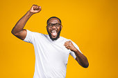 istock Portrait of excited young African American male screaming in shock and amazement. Surprised man looking impressed, can't believe his own luck and success 1163575193