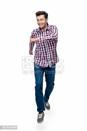 664626542 istock photo Portrait of excited young man jumping by smiling over on white background 937843990