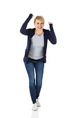 istock Portrait of excited young woman cheering 501736609