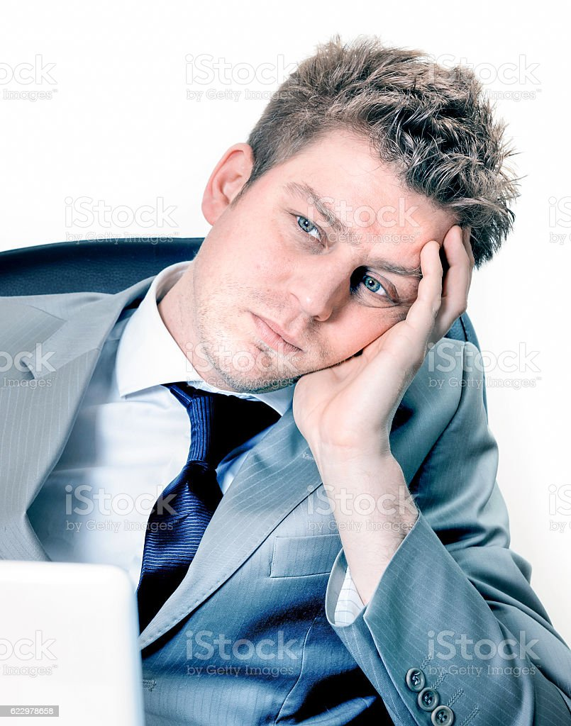 Portrait of  exhausted businessman at the office stock photo