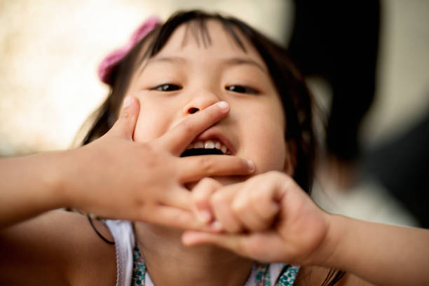 Portrait of expressive asian little girl. stock photo