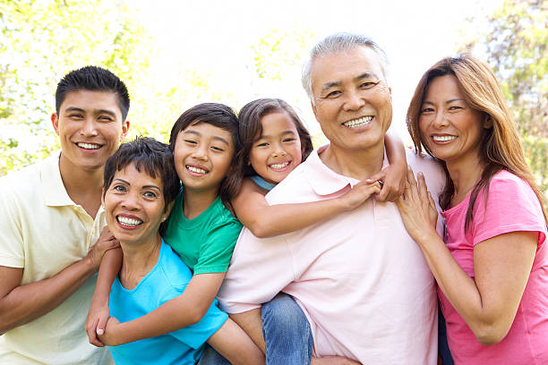 Portrait Of Extended Family Group In Park  filipino ethnicity stock pictures, royalty-free photos & images