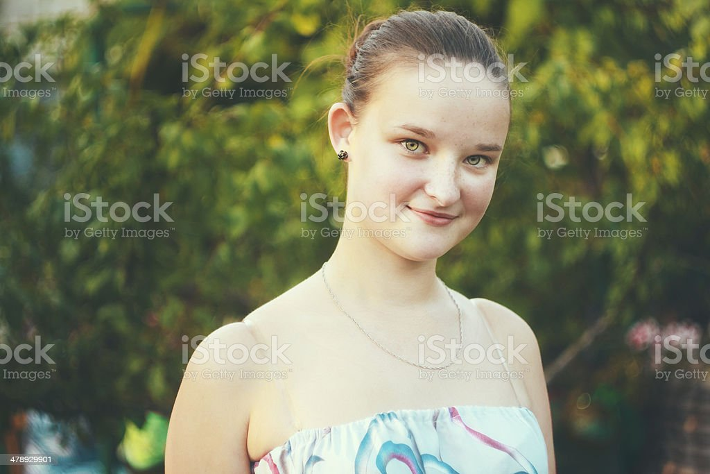 Portrait of face young beautiful girl woman on green outdoor royalty-free stock photo
